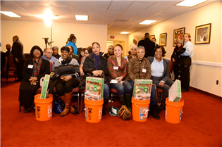 HOAP graduates and homeowners celebrate with their new Home Depot First-Time Homebuyer Kits.