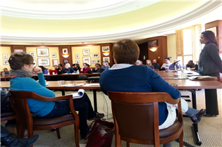 >DCHA Executive Director Adrianne Todman speaks to Harvard graduate students.