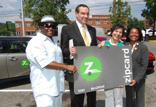 Showing off a BIG Zipcard are (l to r):  Kenneth Council, President of the Ft. Dupont Resident Council, Mayor Vincent Gray, Ellice Perez, General Manager of Zipcar DC, and Adrianne Todman, Executive Director of DC Housing Authority.