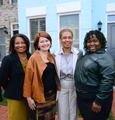 New townhomes at Capitol Quarter were celebrated by (l to r) DCHA Executive Director Adrianne Todman, new homeowner Karen Conwell, Congresswoman Eleanor Holmes Norton, and Chanel Caldwell-Cowan, a returning resident from Arthur Capper public housing.