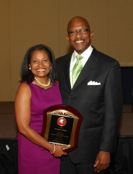 Adrianne Todman, Executive Director of the DC Housing Authority, receives Executive Director of the Year award from NARSAAH Director Samuel B. Little at the organization's national conference in Orlando, FL