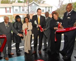 DC Housing Authority's Elvans Court townhomes, renovated at a cost of $2.3 million, at the official grand opening.  From left to right:  DCHA Board member Frank Lancaster, Elvans Court resident Kenya Fulford, DCHA Executive Director Adrianne Todman, Mayor Vincent C. Gray, DCHA Board members Clarence Mobley and Bernadette Tolson, DC Councilmember Michael Brown.