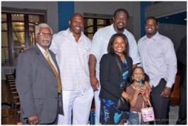 Special guests who attended Saturday's event to support public housing and voucher fathers included (l to r, back row):  Frank Lancaster, DCHA Resident Commissioner; Ken Harvey, former linebacker for the Washington Redskins; Riddick Bowe, two-time World Heavyweight champion, and Washington native Orlando Gary formerly with the Denver Broncos.  Ms. Todman stands in front with Riddick Bowe's daughter.