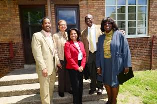 Kenyan McDuffie, Ward 5 Councilmember, Congresswoman Eleanor Holmes Norton, Adrianne Todman, DCHA Executive Director, James Short, and Sandra Henriquez, HUD Assistant Secretary pose in front of 719 Langston Terrace NE, where Mr. Short was born, at the Langston 75th Anniversary celebration.  Mr. Short is retired as Deputy Fire Chief from the DC Fire Department.