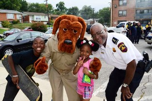 McGruff The Crime Dog and DCHAPD Deputy Chief Jesse Millhouse were just as excited as the kids for National Night Out
