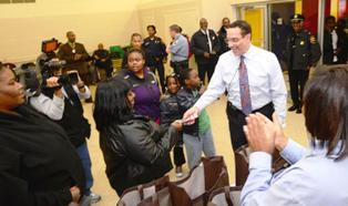 DC Mayor Vincent Gray started off the holiday season with more that just food, as some lucky DCHA residents also received tickets to basketball games with one of DC's two home teams, the Washington Wizards or the Georgetown Hoyas.