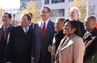 From left: Michael Stevens, Chris Smith, Mayor Gray, Eleanor Holmes Norton, Tommy Wells, Adrianne Todman, and Lionell Thomas of the DC Commission on the Arts and Humanities.
